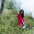 Woman in red dress with tree wolfs in forest — Stock Photo
