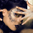 Stock Photo: Fashion portrait of pretty young womwith creative make up like snake