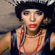 Stock Photo: Young pretty womwith make up like red indian
