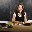 Stock Photo: Portrait of happy cute student in classroom at blackboard