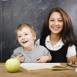 Stock Photo: Little cute boy with teacher in classroom