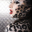 Portrait of beautiful young european model in cat make-up and bodyart — Stock Photo #37419043