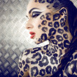 Portrait of beautiful young european model in cat make-up and bodyart — Stock Photo #37419077