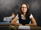 Little cute boy with teacher in classroom — Stock Photo