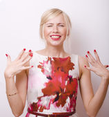 Blond emotional woman with red lips and nails — Stockfoto