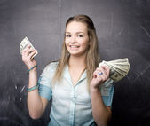 Portrait of cute girl student with money and passport — Stock Photo
