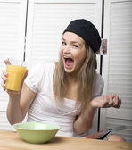 Portrait of funny teenage girl in white dress and sunglasses, having breakfast — Foto de Stock
