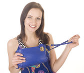 Portrait of beautiful young woman with little hand bag — Stock Photo