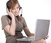 Portrait of woman with laptop and hands free — Stock Photo
