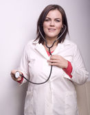 Portrait of young smiling doctor with stethoscope — Stock Photo