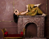 Beauty sensual young woman in oriental style in luxury room — Stock Photo