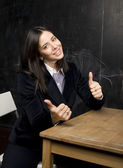 Portrait of happy cute student in classroom — Photo