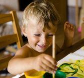 Portrait of little boy painting — Stock Photo