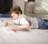 Portrait of little cute boy painting on floor — Foto de Stock
