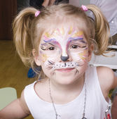 Little girl with faceart on birthday party — Stock Photo