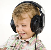 Portrait of little cute boy in earphones — Stock Photo
