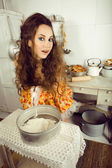 Crazy housewife on kitchen — Stock Photo