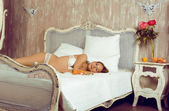 Beauty woman in bed in white interior — Foto de Stock