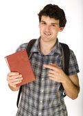 Jovem estudante feliz carregando saco e livros — Fotografia Stock