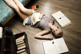 Every one has his own cockroaches, beauty girl among books — Stock Photo
