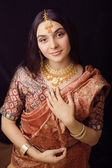 Beauty sweet indian girl in sari smiling — Stock Photo