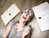 Portrait of crazy student in glasses with books and cockroaches — Stock Photo