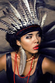 Young pretty woman with make up like red indian — Stock Photo