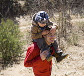Happy father with son in forest playing — Stock Photo