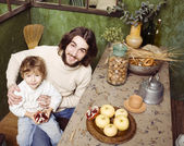 Portrait of happy father and son in kitchen — Foto Stock