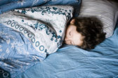 Little boy sleeping in bed — Stock Photo