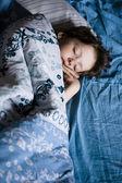 Little boy sleeping in bed — Stok fotoğraf