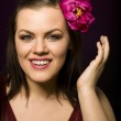 Portrait of beauty brunette woman with flower in her hair — Stock Photo #37423519