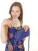 Portrait of beauty young woman with piggy bank and money — Stockfoto