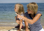 Portrait of young family having fun on the beach, mother and daughter at sea — Foto de Stock