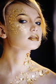 Beauty blond woman with gold creative make up — Stock Photo