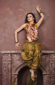 Portrait of beauty sensual young woman in oriental style in luxury room — Stok fotoğraf