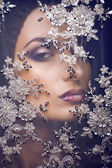 Portrait of beauty young woman through lace — Stockfoto