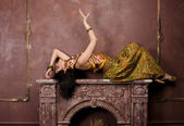 Portrait of beauty sensual young woman in oriental style in luxury room — Stock Photo