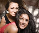 Portrait of two pretty girls enjoying party — Stockfoto