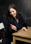Portrait of happy cute student in classroom — Stock Photo