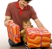 Happy family with big gift box. Isolated. — Stock Photo