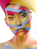 Woman with creative geometry make up, tree color red, yellow, blue — Stock Photo