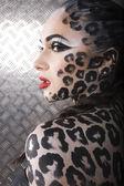 Portrait of beautiful young european model in cat make-up and bodyart — ストック写真