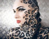 Portrait of beautiful young european model in cat make-up and bodyart — Stock Photo