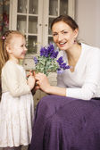 Young mother with daughter at home — Stock Photo