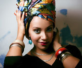 Beauty bright african woman with creative make up, shawl on head — Stock Photo