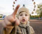 Little cute boy outside in park near carousel — ストック写真