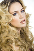Beauty blond woman with long curly hair close up — Stock Photo