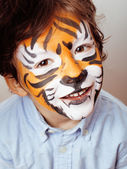 Little cute boy with faceart on birthday party close up — Stock Photo