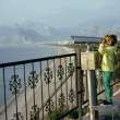 Little cute boy looking through telescope at sea viewpoint — Stock Photo #41677307